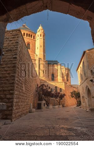 View of the Dormition Abbey from arch of old street, Jerusalem, Israel
