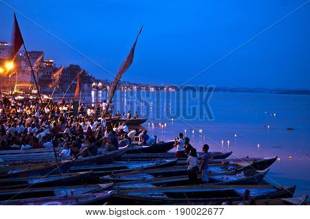 Varanasi India- 30 Jule 2011: Hindu people watching religious Ganga Aarti ritual (fire puja) from the water