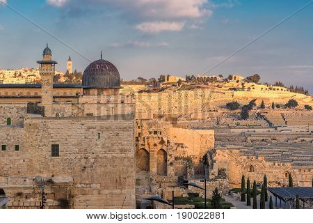 Sunset view of Al-Aqsa Mosque and Mount of Olives in Jerusalem Old City