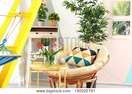 Interior of beautiful modern veranda with cozy furniture and home plants