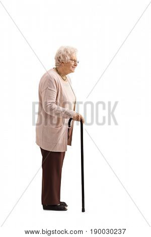Full length profile shot of a mature woman with a cane waiting in line isolated on white background