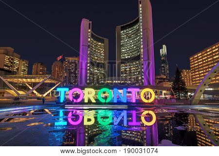 Toronto city hall and Toronto Sign in downtown at twilight, in Toronto, Canada