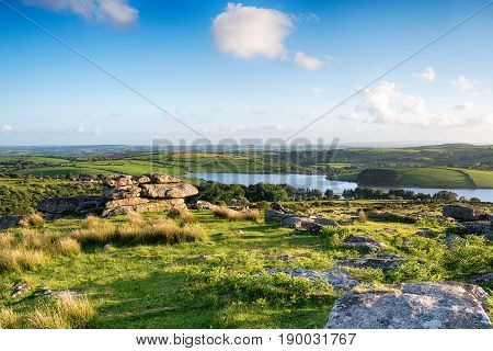 Looking out over the Cornwall countryside from the top of Tregarrick Tor above Siblyback Lake on Bodmin Moor