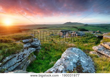 Stunning sunset from the top of Garrow Tor on Bodmin Moor in Cornwall with Roughtor in the distance