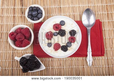 Bowl Of White Yogurt With Berries And Oat Flakes Isolated