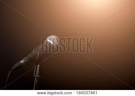 Microphone in light of spotlight