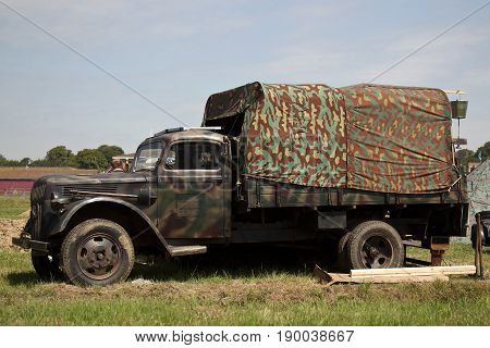 WESTERNHANGER, UK - JULY 18: An ex WW2 German army GS truck is stationed in the living history field for the public to view at the War & Peace Revival show on July 18, 2014 in Westernhanger