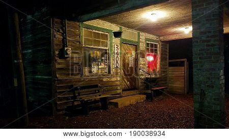 An old rundown country tavern at night.