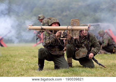 DENMEAD, UK - MAY 25: A pair of WW2 German army re-enactors let loose their anti tank bazooka at allied armour during the battle re-enactment at the Overlord show on May 25, 2014 in Denmead