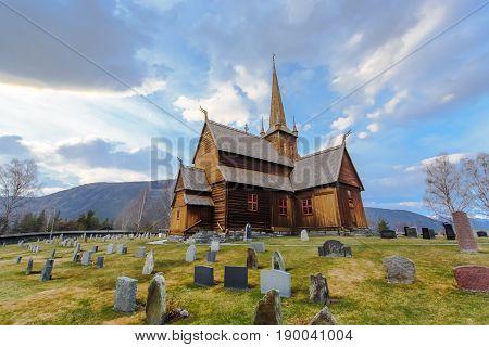 Lom stave church (Lom stavkyrkje) with graveyard foreground Lom Norway