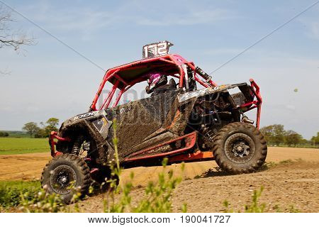 ARNCOTT, UK - MAY 4: An unnamed driver competing in the UK SXS RZR series exits the table top ramp on May 4, 2014 in Arncott