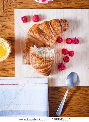 delicious continental breakfast of orange juice and croissants