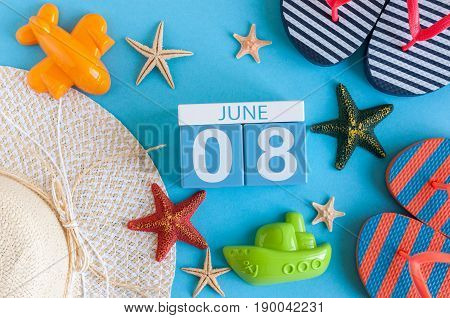 June 8th. Image of june 8 calendar on blue background with summer beach, traveler outfit and accessories. Summer day.
