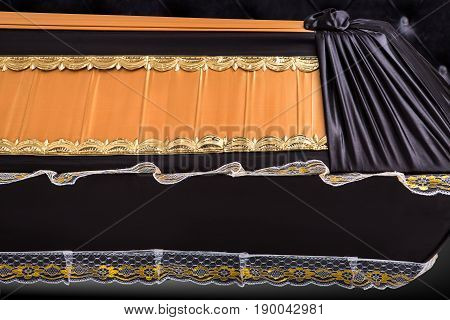 closed beige coffin covered with cloth isolated on gray background. coffin close-up on royal background. Ritual objects for burial. Surrender body dust of the earth. Christian funeral ritual
