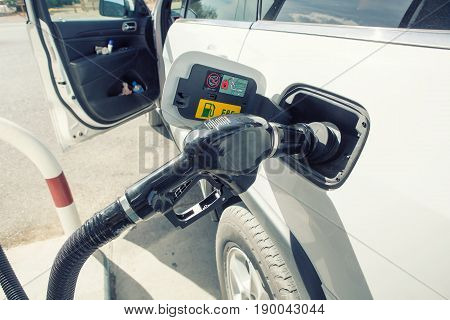 Car refueling on petrol station. To fill the machine with fuel. Car refueling with gasoline at gas station. Fuel pump at station. filter effect