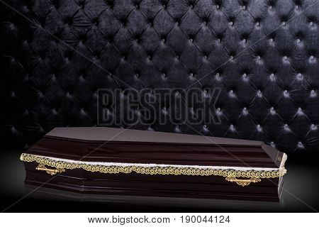 closed wooden brown coffin isolated on gray luxury background. casket, coffin on royal background. Ritual objects for burial. Conduct of the deceased on his last journey. Surrender body dust of the earth. Christian funeral ritual