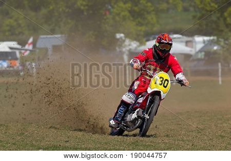 ALVELEY,UK - MAY 7: A rider competing in the Bewdley MCC spring grasstrack meeting leads the field while the remaining competitors enter the bottom corner on May 7, 2017 in Alveley