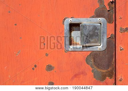 Old worn metal surface with orange paint. Rusty metal texture. Metal sheet with rust and worn paint. Background. Metal. Wall. Floor.