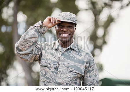 Portrait of happy military soldier in boot camp