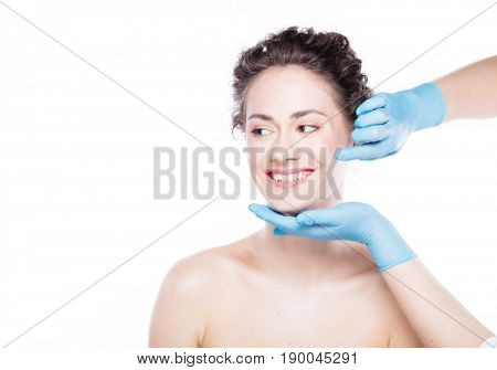 Aesthetic medicine. Young beautiful woman's skin review before treatment. Anti-aging skincare and plastic surgery concept.