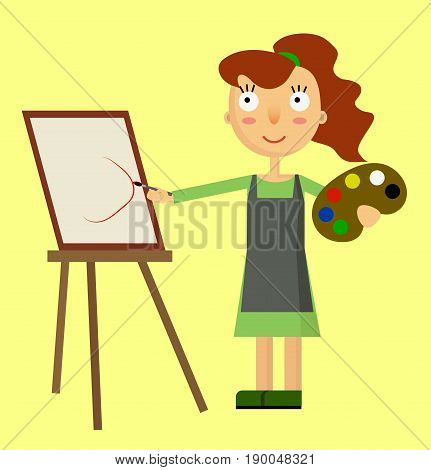 Beautiful artist woman painting a picture on canvas
