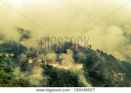 View Of Trongsa Dzong With Foggy Hills, Bumthang, Bhutan, Asia.