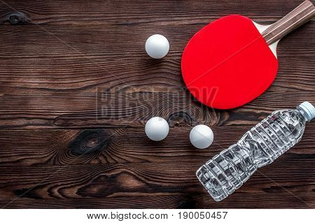 tennis racquet - fitness in the wooden background top view.