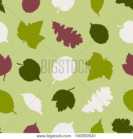 Seamless pattern with silhouettes of leaves of trees of an oak, a birch, a linden. Hand drawn. Vector illustration.