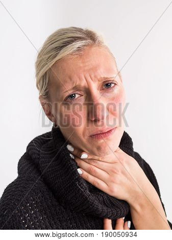 Sore throat of a women on white background