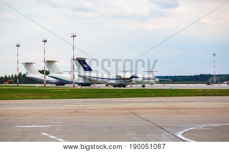 Minsk Belarus - August 30 2014: Passenger planes on the runway of the airport Minsk 2. Arplanes at the airport. Selective focus.