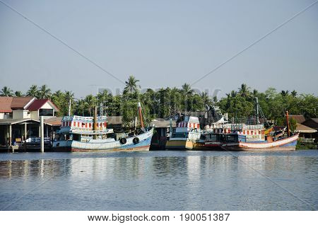 Wooden Fishery Boat Floating And Stop Wait For Go To Catching Fish In The Sea In Evening Time At Mae