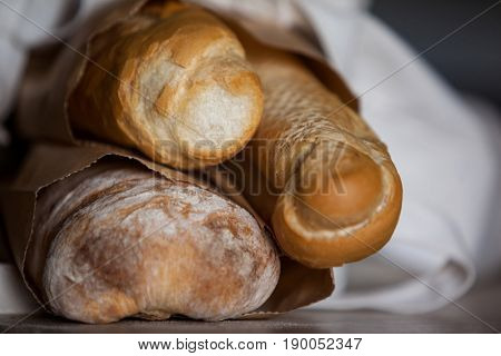 Close-up of bread loaf in paper bag