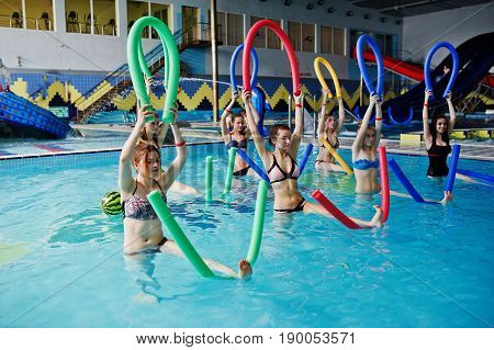Fitness Group Of Girls Doing Aerobical Excercises In Swimming Pool At Aqua Park. Sport And Leisure A