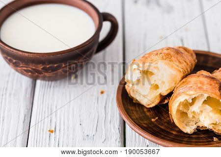 Breakfast With Croissants And Milk. White Rustic Table
