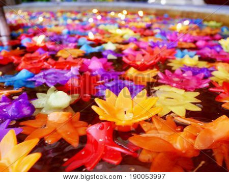 Ritual Praying Colorful Candle Floating On Water For Pray Buddha