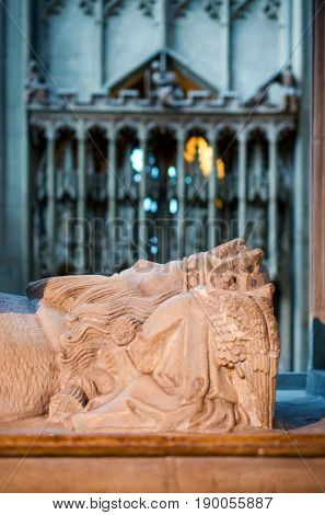 Gloucester United Kingdom - June 8 2013: Close-up details view of tomb of Osric anglo-saxon King of the Hwicce in Gloucester Cathedral which is founded by him in the year 678.