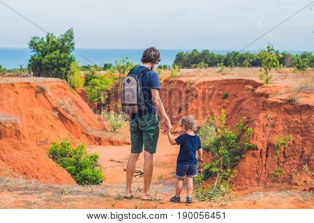 Father And Son Travelers In Red Canyon Near Mui Ne, Southern Vietnam. Traveling With Children Concep