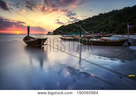 Silhouette Fisherman boat at sunset . Fishermen fishing boat  in beach side Thailand.
