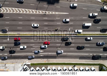 Top view of moving cars and buses in the main avenue (23 de Maio) in Sao Paulo, Brazil