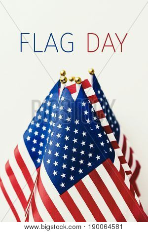 the text flag day and many flags of the United States against an off-white background