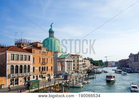 VENICE,ITALY- May 18, 2017. Tourists on water street with Gondola in Venice. its entirety is listed as a World Heritage Site, along with its lagoon