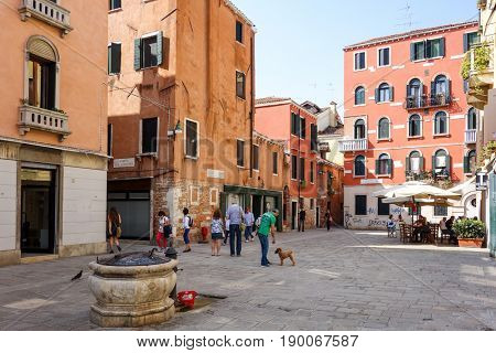 VENICE, ITALY - May 18, 2017.Tourists foot Street in Venice. its entirety is listed as a World Heritage Site, along with its lagoon. VENICE, ITALY