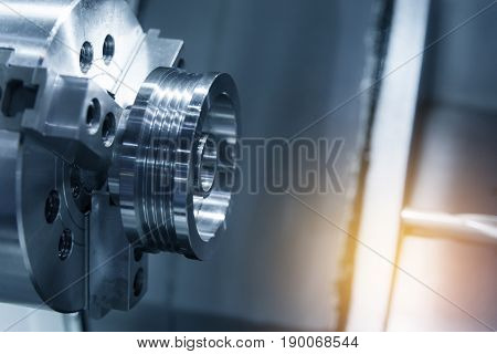 Abstract scene of CNC lath machine (Turning machine) while cutting the screw thread on the tube.The hi-technology machining concept.