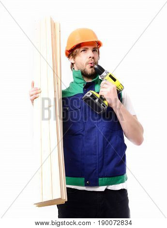 Worker with thoughtful face expression powered yellow drilling tool and construction board in hand isolated on white background. Concept of finished job building and professional experience