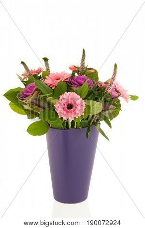 Bouquet with Gerber flowers and decoration cabbage in blue vase