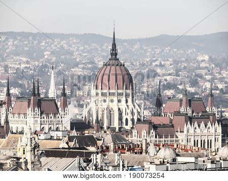 Huge dome of Hungarian Parliament Building - Orszaghaz. Unusual view from St. Stephen's Basilica. Budapes, Hungary.