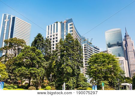 Green Trees And Skyscrapers In Guangzhou City