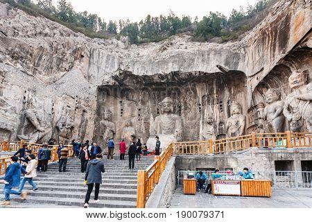 People Near Big Vairocana Sculpture In Main Cave