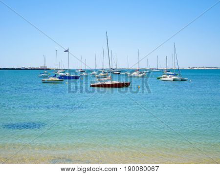 Yachts are moored on buoys in the sea
