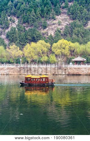 Boat In Yi River Between West And East Hills